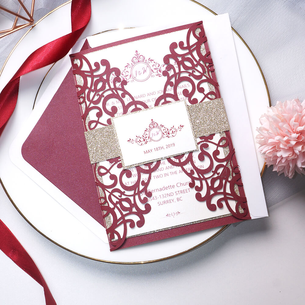 Classic laser cut invite features monogram design in botanical surrounded pattern, adding a touch of vintage. The set is finished