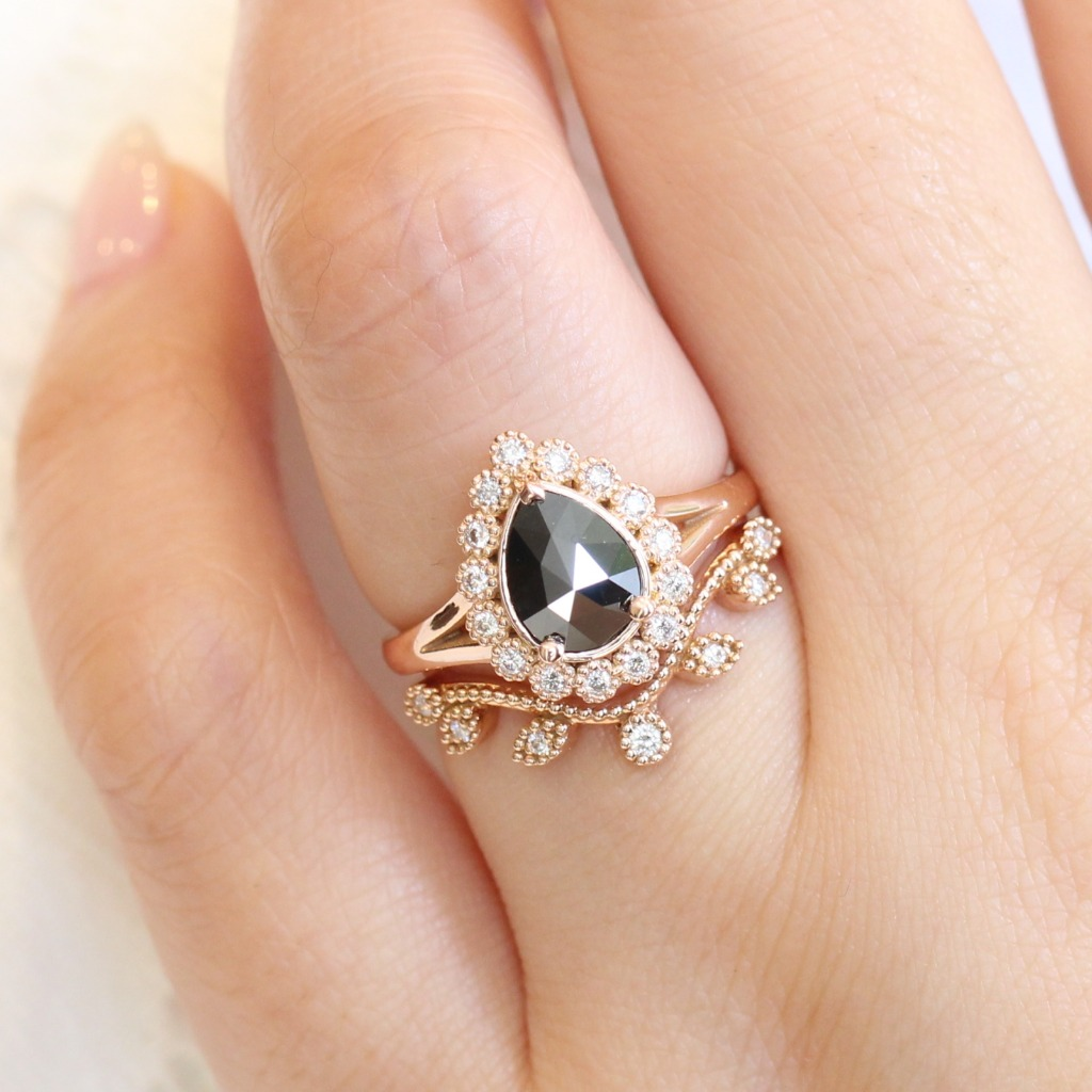 Exquisite bridal ring set of a rose cut black diamond engagement ring in 14k rose gold vintage luna halo diamond ring setting and completed