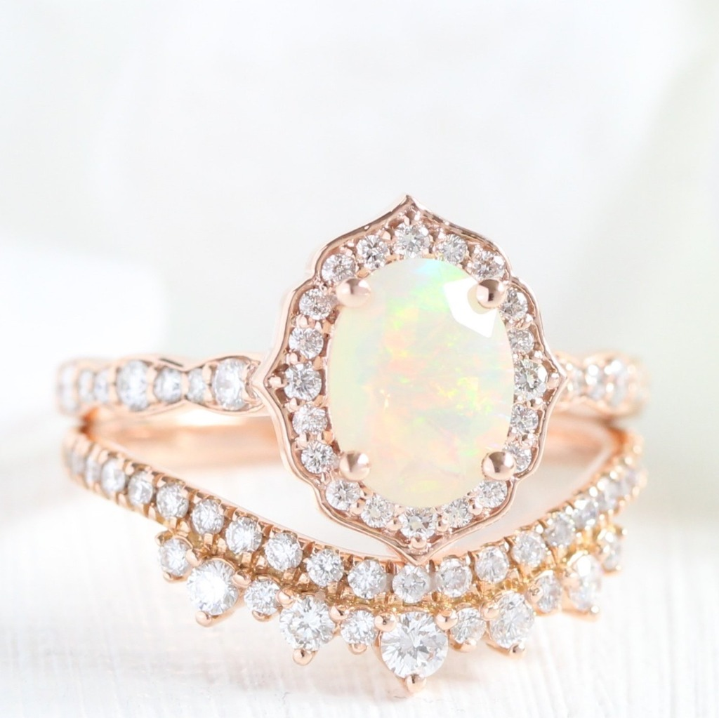 Gracefully handcrafted vintage inspired opal bridal set showcases a vintage floral opal engagement ring in 14k rose gold scalloped