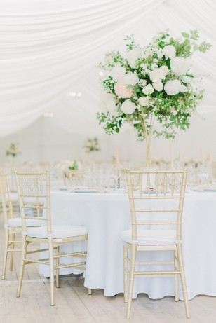 gold and white tented wedding reception