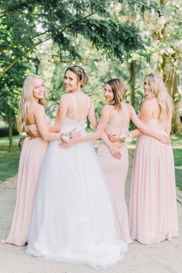 bridal party in beautiful blush dresses
