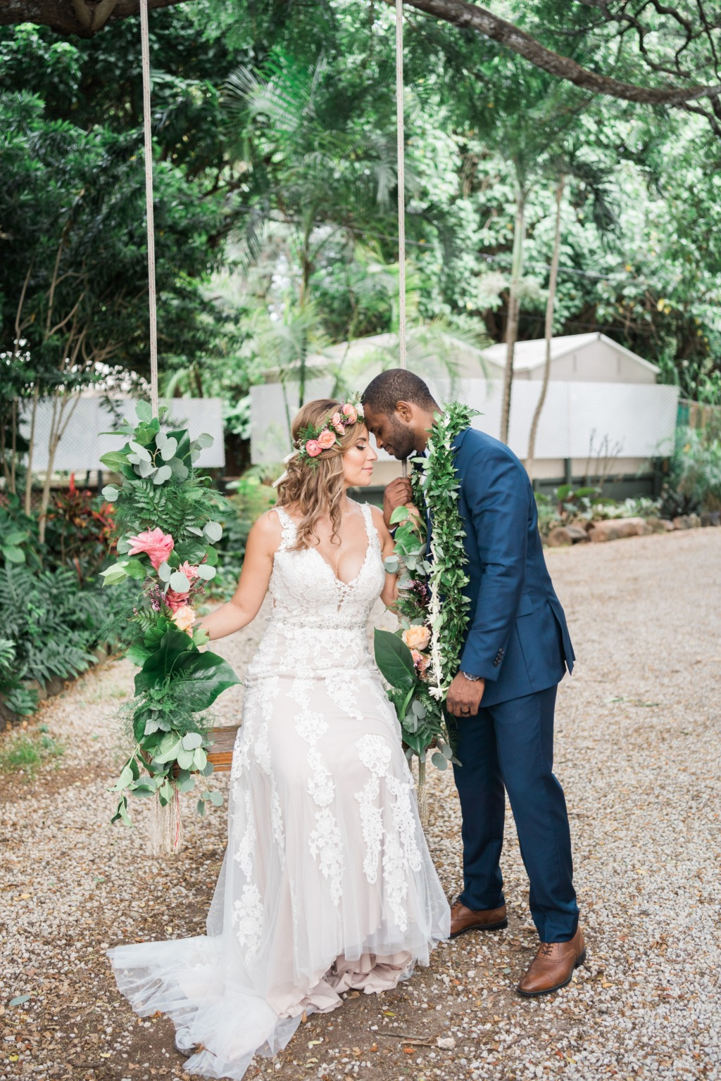 Briana and Wilrey got married at Loulu Palm Estate on the North Shore near Haleiwa on Oahu, Hawaii! This swing adorned in flowers