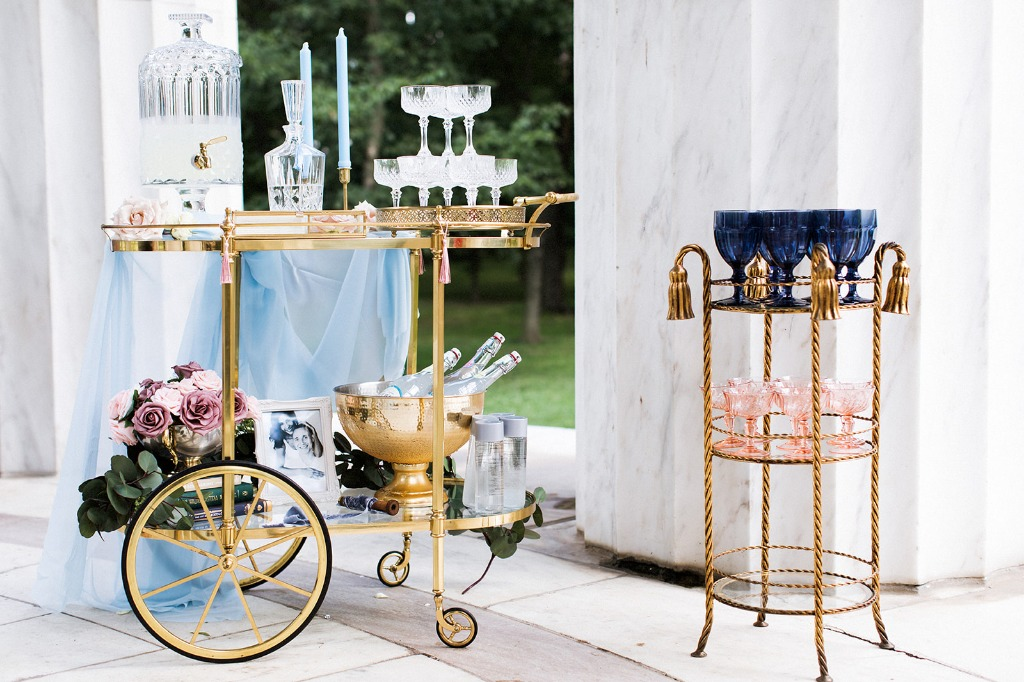 A beautiful way to greet guests as they arrive at your wedding. This lemonade cart featured vintage coupes and goblets that matched