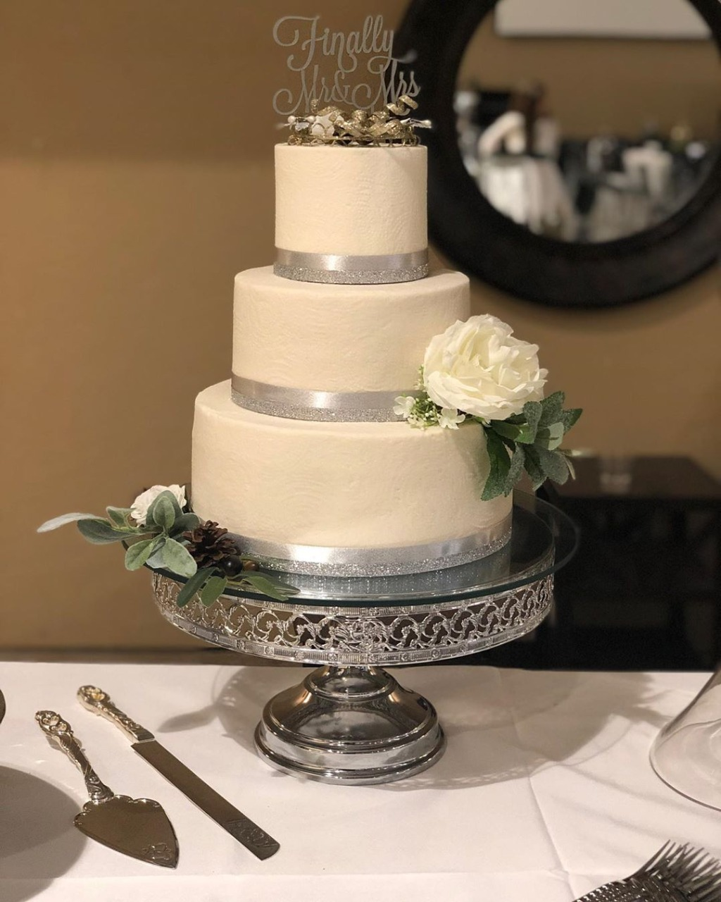 Classic Ivory Wedding Cake with Silver Accents! Wedding Cake by Mishelle Handy Cakes on an Opulent Treasures Shiny Silver Wedding Cake