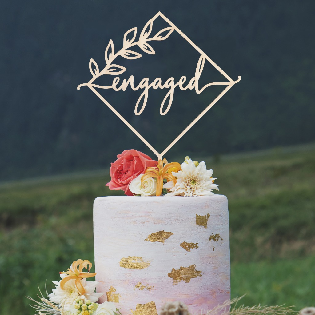 Just Engaged? Celebrate this exciting occasion with this beautiful engagement cake topper and give your family and friends a sneak