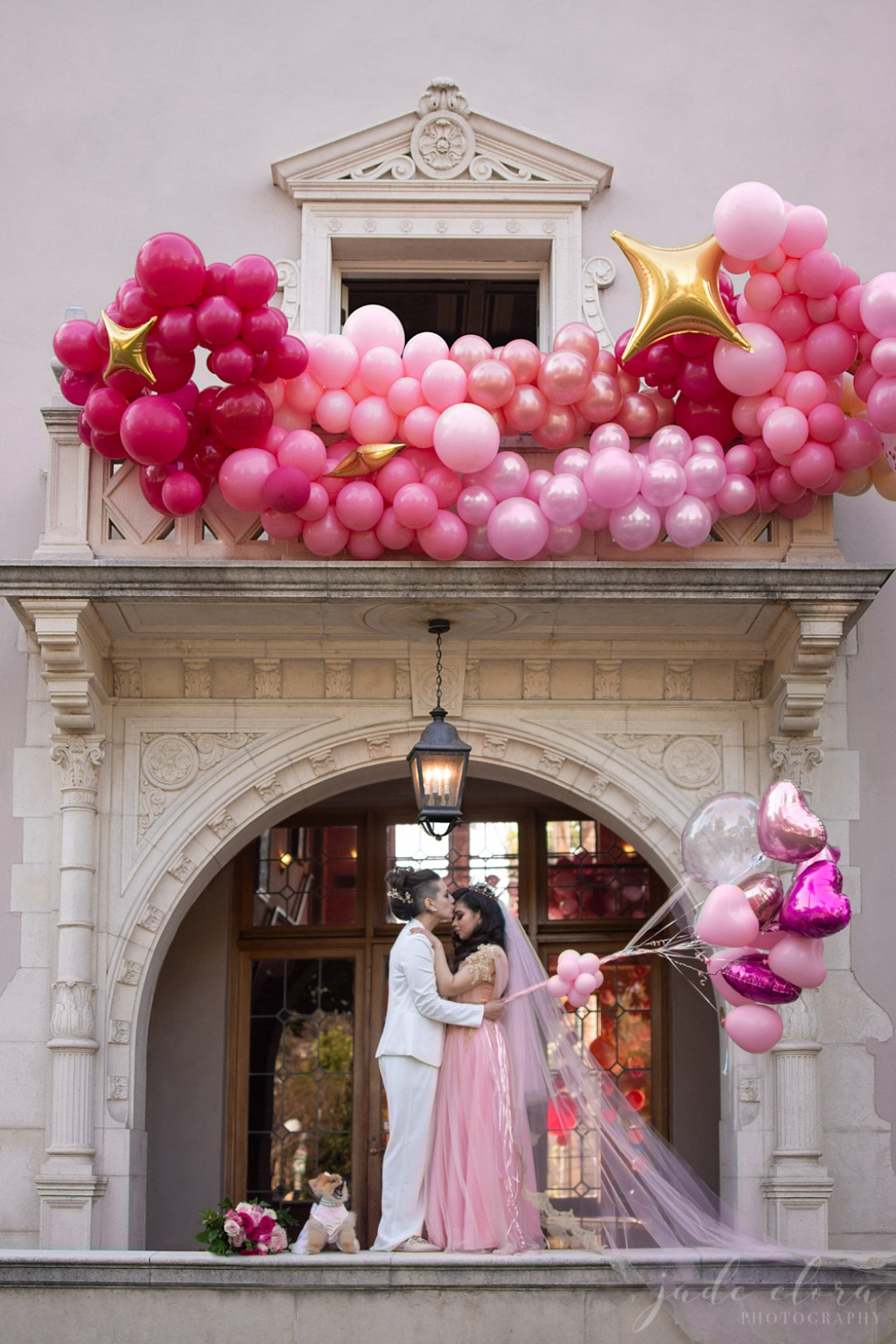 This magical same-sex wedding, inspired by Glinda the Good Witch, features balloons and an explosion of pink, plus an adorable couple