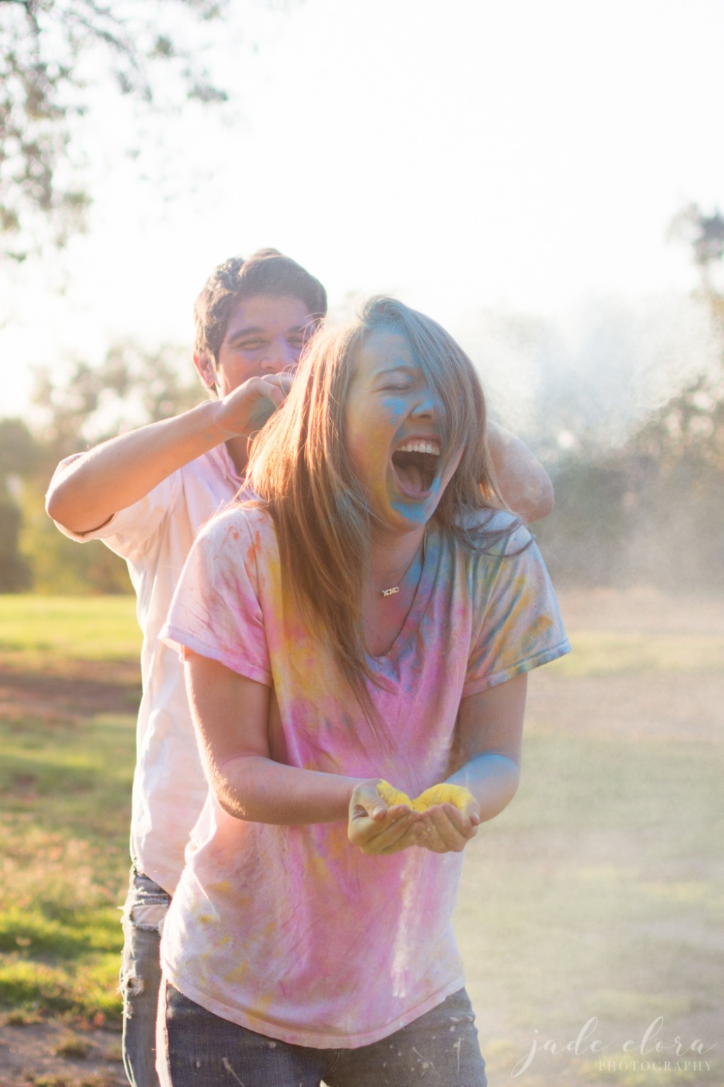 This playful couple gets super-colorful with an engagement photo shoot full of bright colored powders and a whole lot of fun.