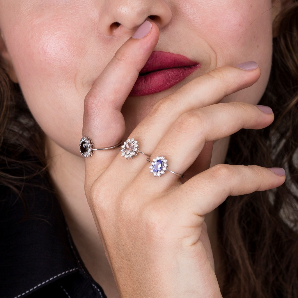 Shop unique gemstone engagement rings that are stylish and beautiful. The rings are made in tanzanite and smoky topaz as centerstone