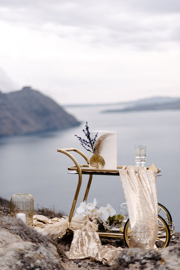 gold cake table in Santorini