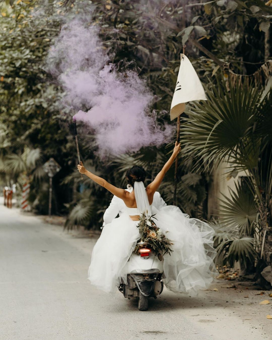 Tulum • The bridal gown• The ride • The colored smoke bomb • The flowers • The YAY flag • The most perfect bride and groom