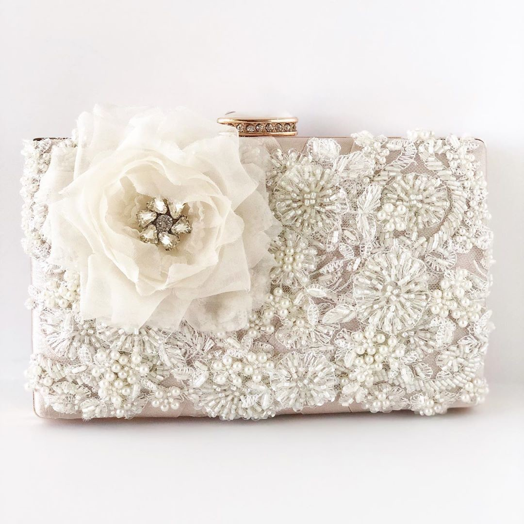 Just a pretty little touch of flower details. This bridal clutch has gorgeous beaded small flower embellishments.