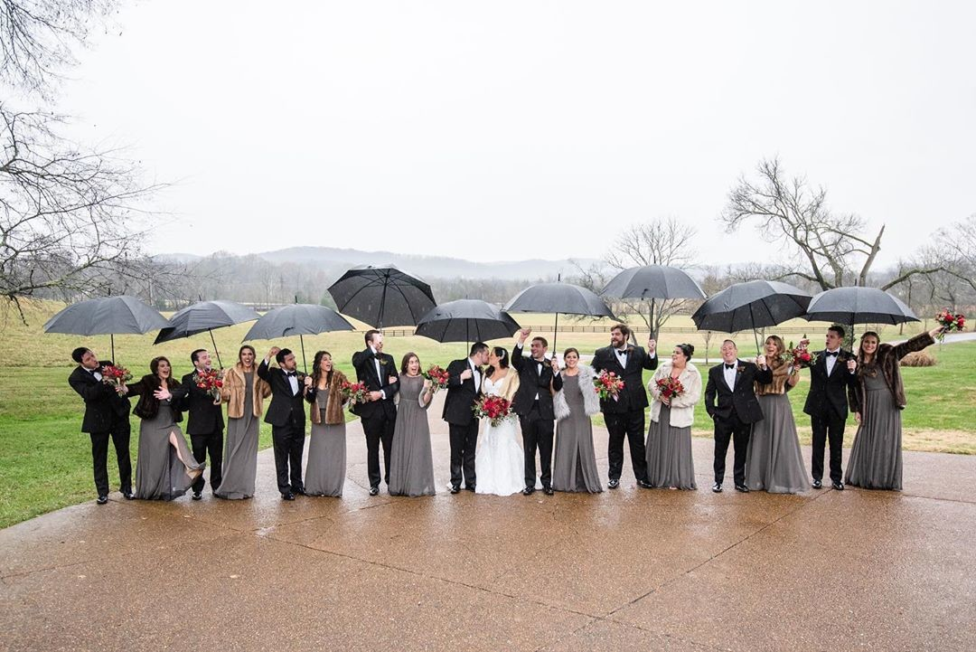 Rain on your wedding day, no problem! @jamieannkiser is one of