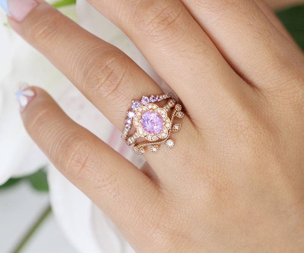 One of our One of A Kind Engagement Rings, an oval cut Vintage Floral ring with Lavender Purple Sapphire in Scalloped Diamond Band