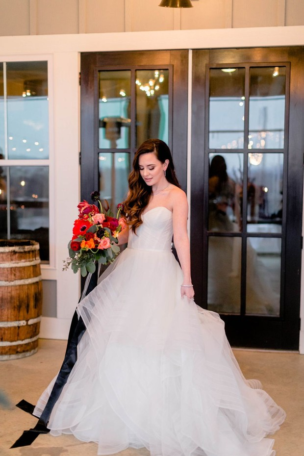 bride in elegant tulle tiered wedding dress