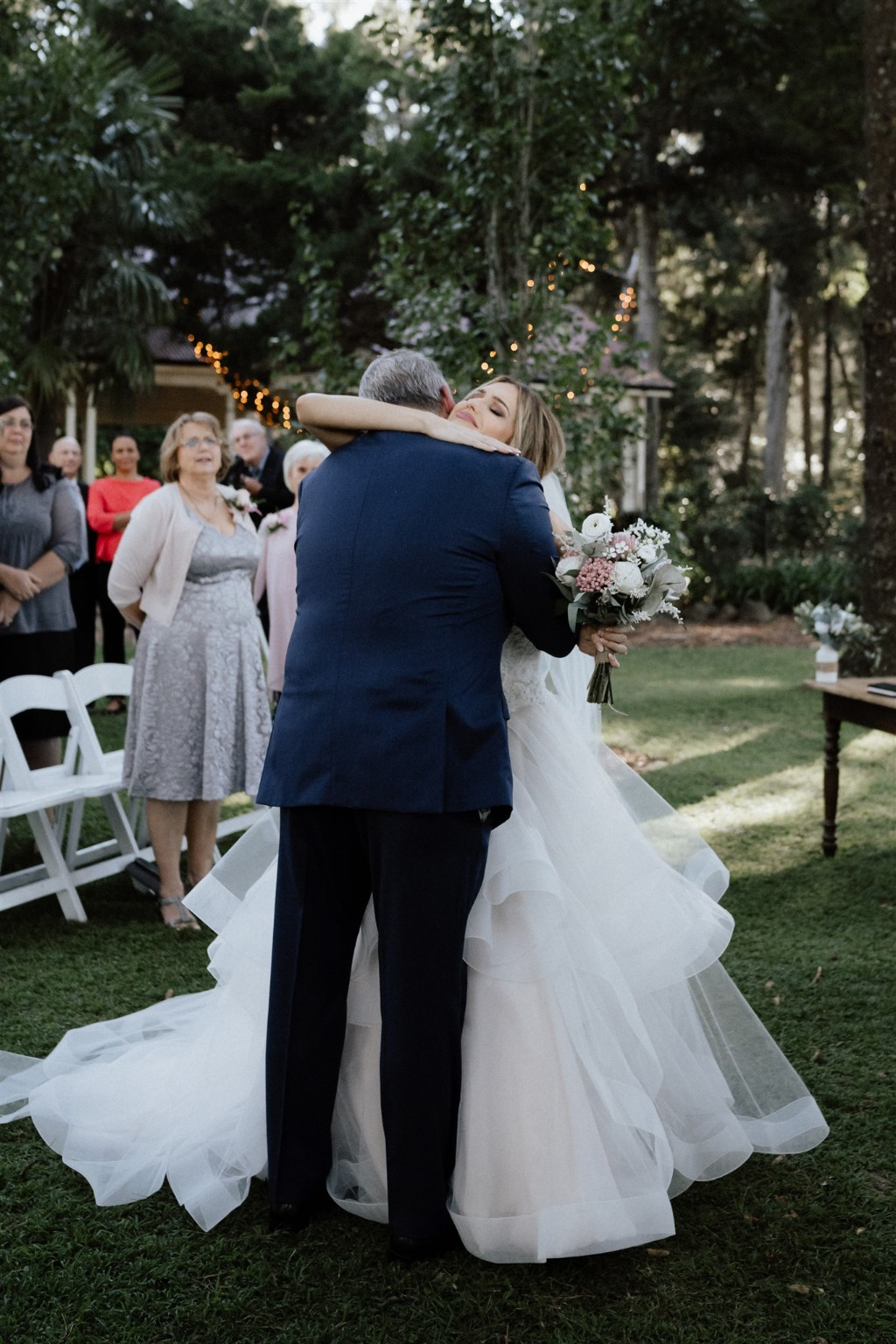 The giving away of the bride - A heart warming moment between father and daughter. View the full real wedding with Celebrant Jamie