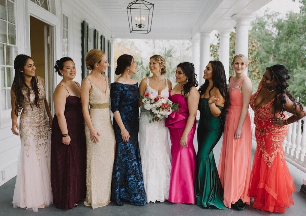 We love when brides want their maid's personalities to shine through their dresses. The bold color choices are just gorgeous!