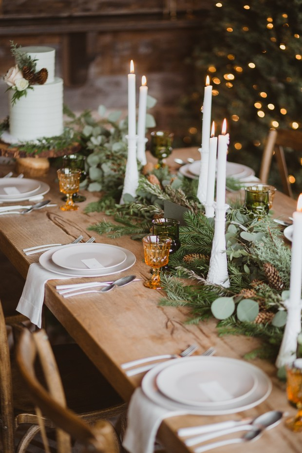 rustic wintertime pine accented wedding table decor