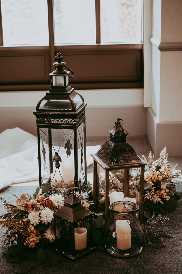 vintage lanterns flowers and candles for your wedding ceremony decor