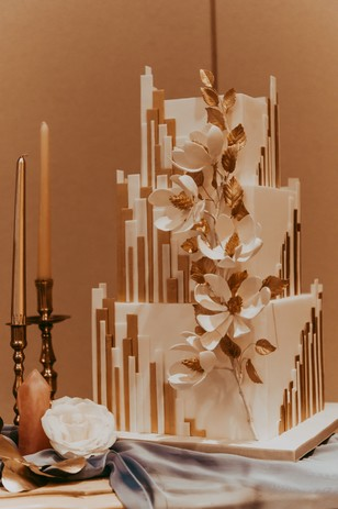 art deco wedding cake in gold and white