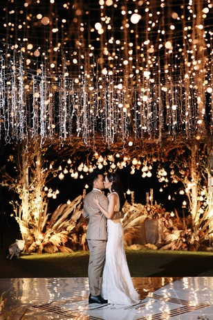 dreamy first dance dripping in hanging lights