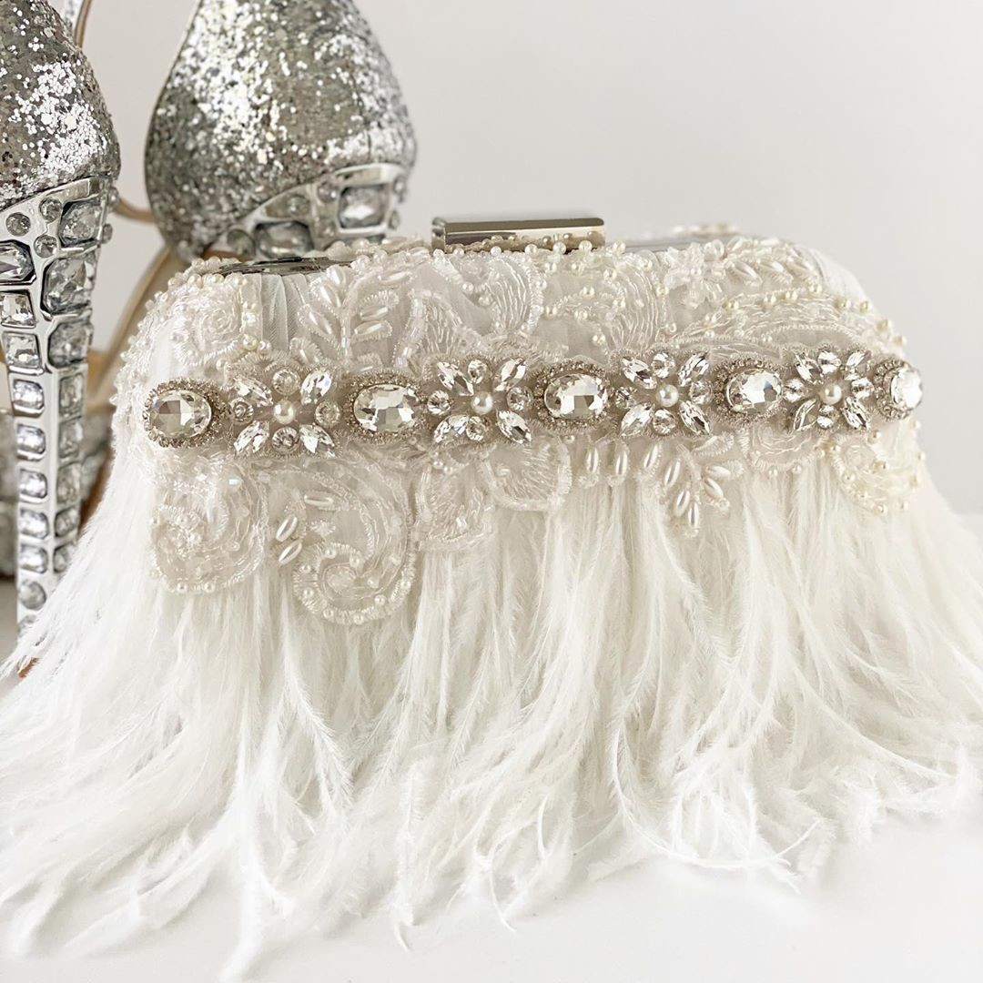 Glam is what this brand New bridal clutch is all about. I even designed both sides with gorgeous off white ostrich feathers and rhinestones