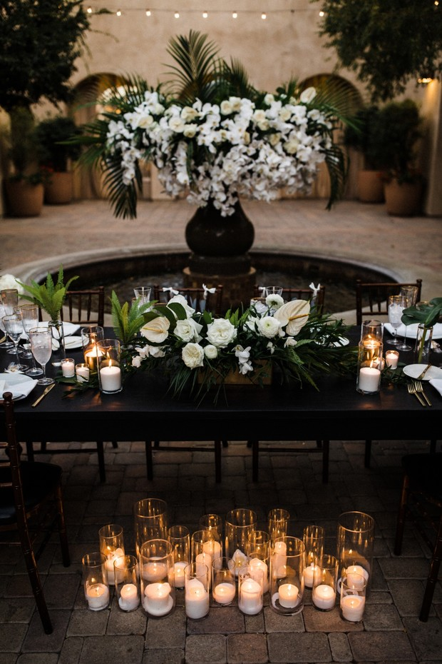 white and green tropical floral decor for your reception