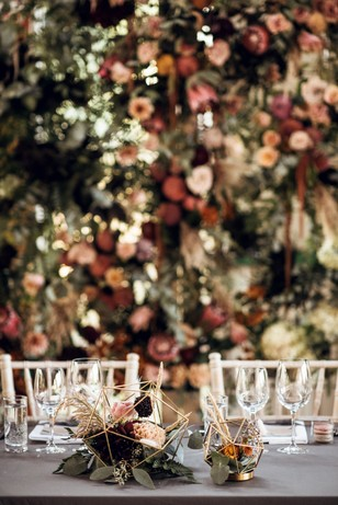 sweetheart wedding table with flower backdrop