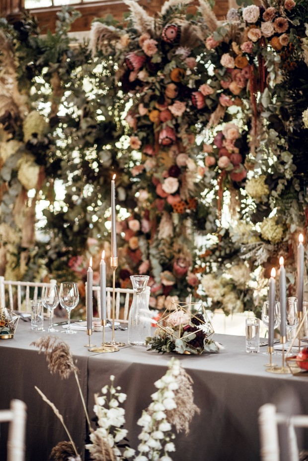 wedding reception with flower backdrop