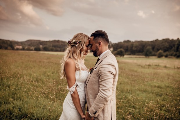 romantic wedding couple photo in a field
