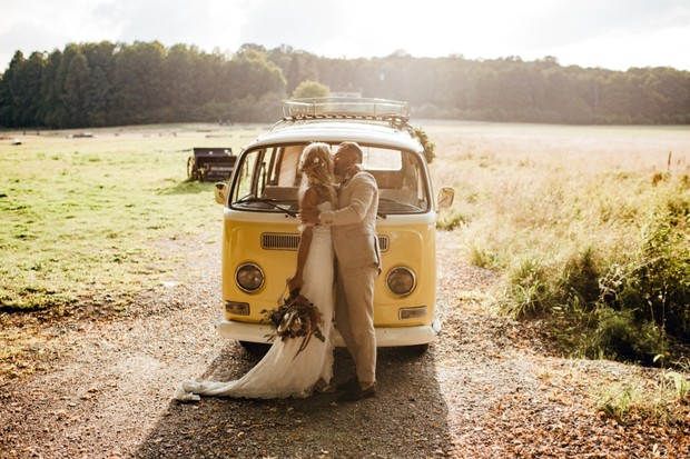 wedding couple with their yellow VW bus getaway car