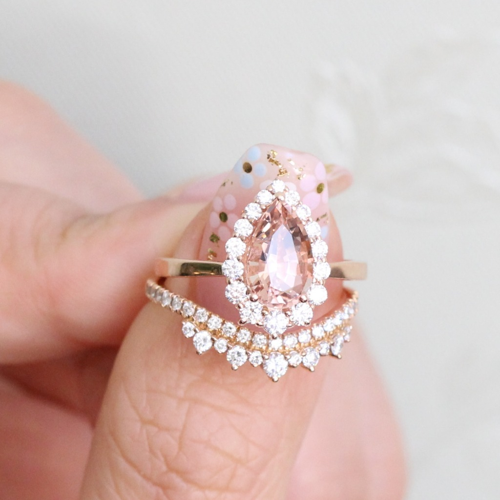 Morganite lovers, can we see a raise of hands? This peachy gemstone Pear cut Morganite in Tiara Halo Ring Setting is so gorgeous and