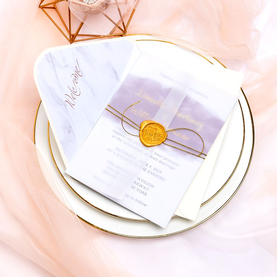 Simple vellum invitation features mauve watercolor design and matching foil names. We fall for the mild and mysterious tone of light