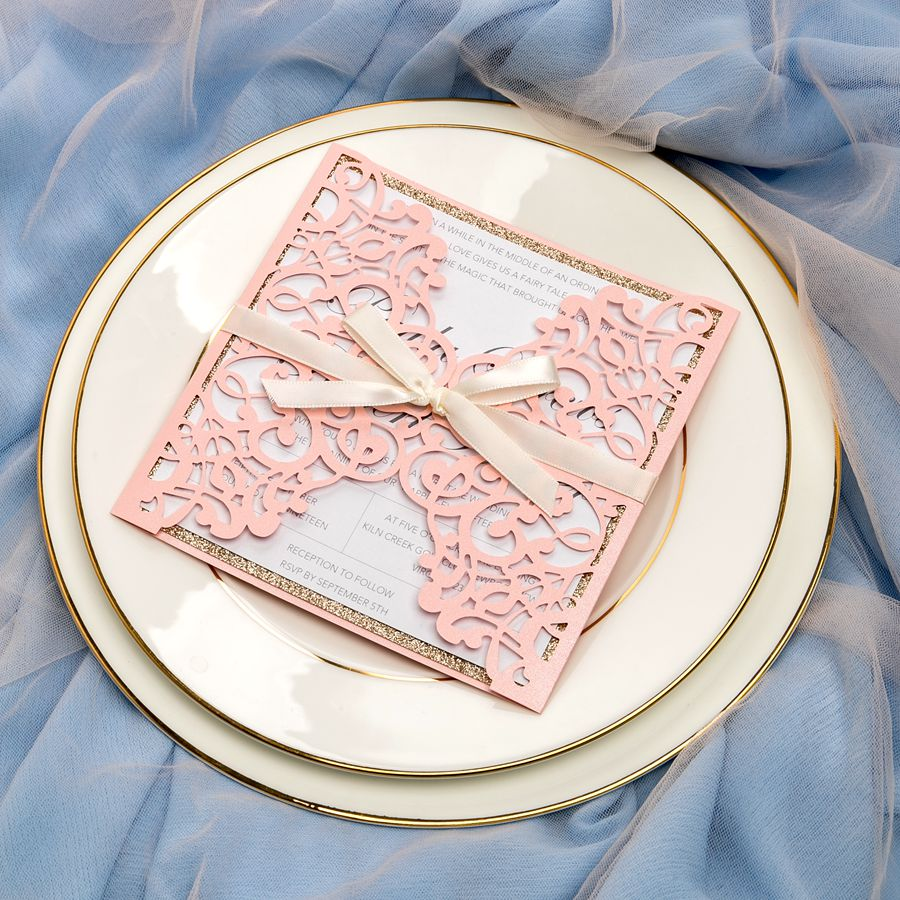 This invitation combines pink loveliness with golden luxury. And the floral laser cutting adds in more romance combined with blush