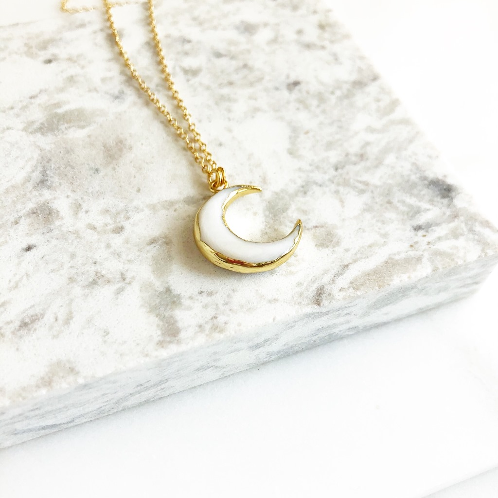 The natural white shell crescent measures approximately 18mm x 20mm. The chain is 14k gold filled and the necklace is 18 long. Great