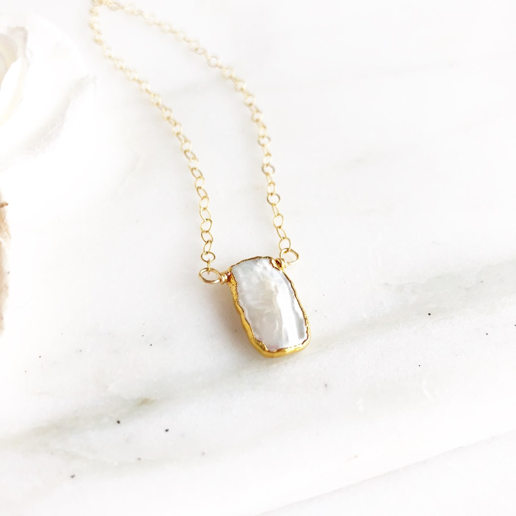 This sweet necklace is a unique take on a classic look. On 18 dainty 14k gold filled chain.