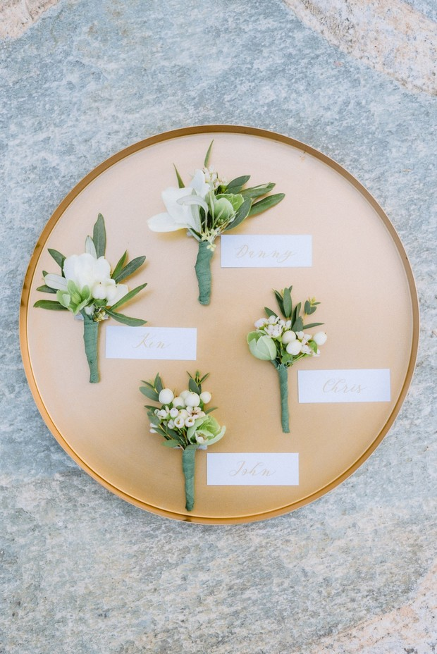 simple and white boutonnieres