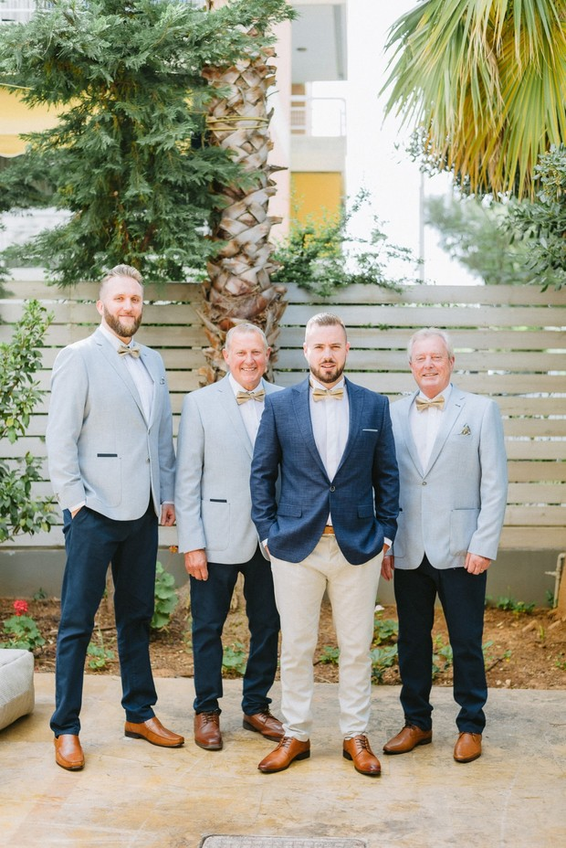 grey and blue groom and his groomsmen