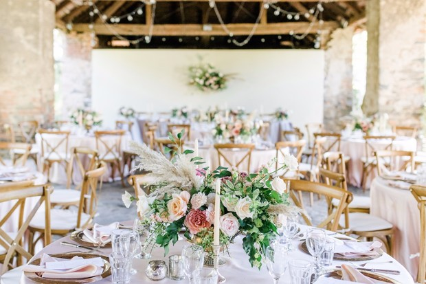 indoor outdoor wedding reception in blush and gold