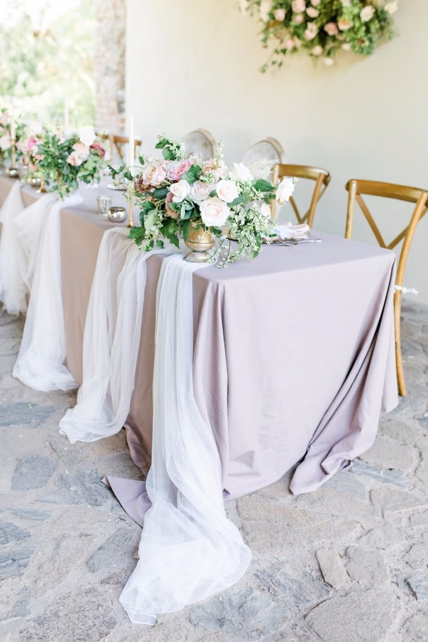 soft blush and romantic wedding party table