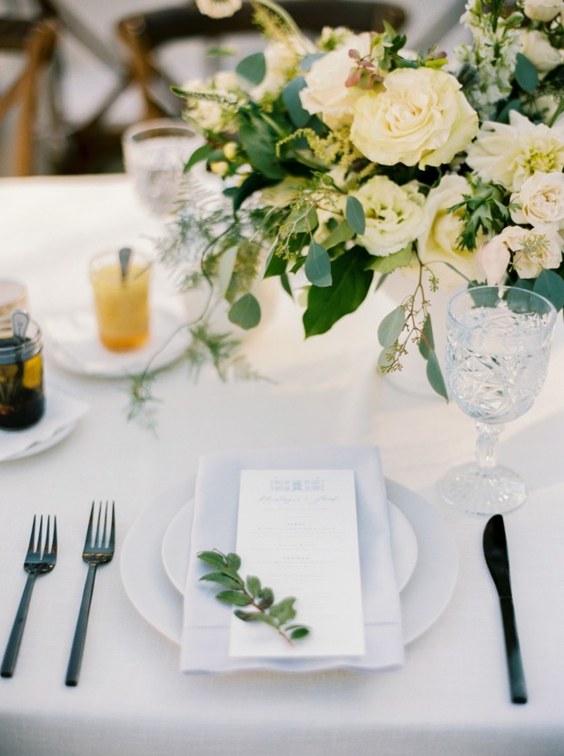 soft grey and white garden wedding reception place setting