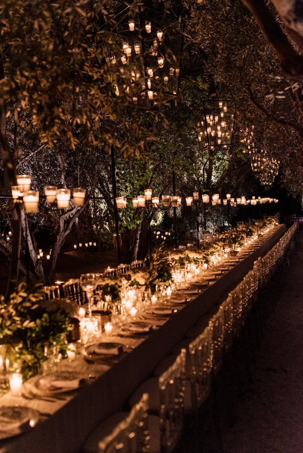 outdoor wedding ceremony with family feast style seating