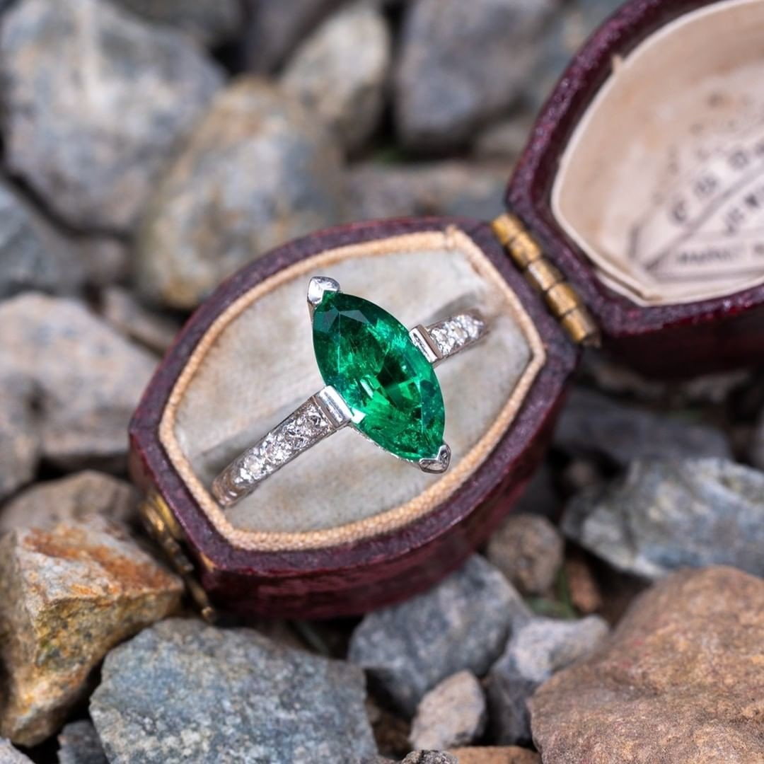1930's Marquise Emerald Engraved Platinum Ring. Sku RR14444.