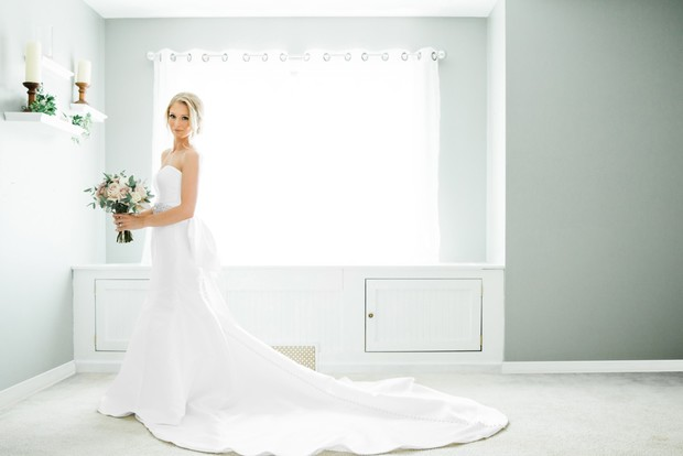 white wedding dress with a bow