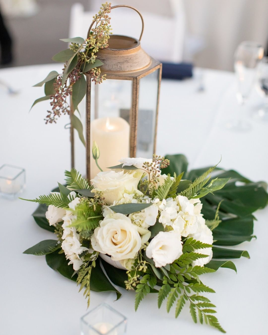 We loved this lantern look! These were first used down the aisle for the ceremony, then repurposed as centerpieces for the reception