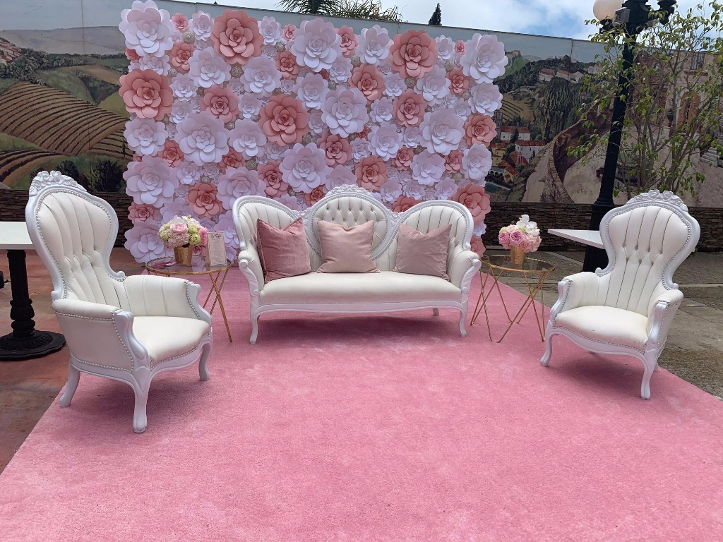 We created this 8 feet by 12 feet custom flower backdrop with white and light pink camellia flowers. This flower wall has several jewels
