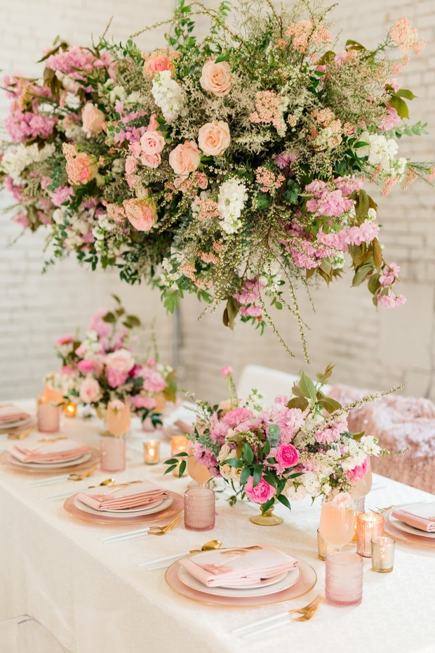 floating pink floral wedding chandelier and modern pink and gold table decor