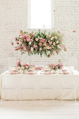 white and pink wedding reception floral decor
