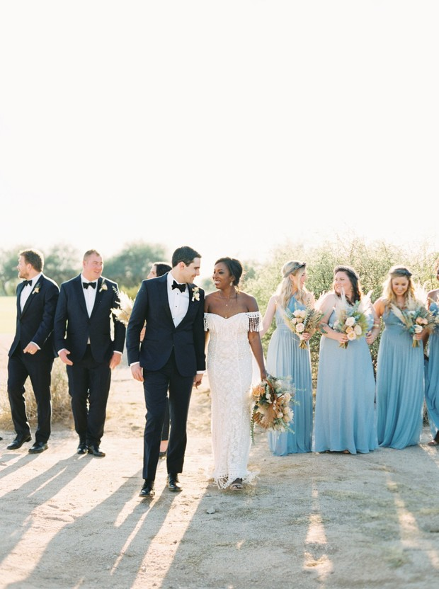 wedding party in black tie and soft blue