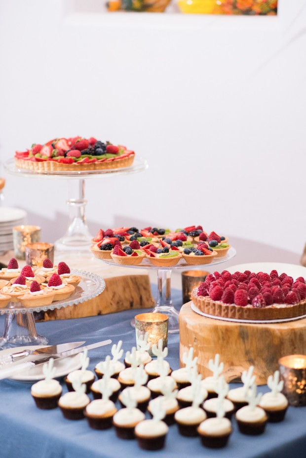 fruit tart and cupcakes dessert table