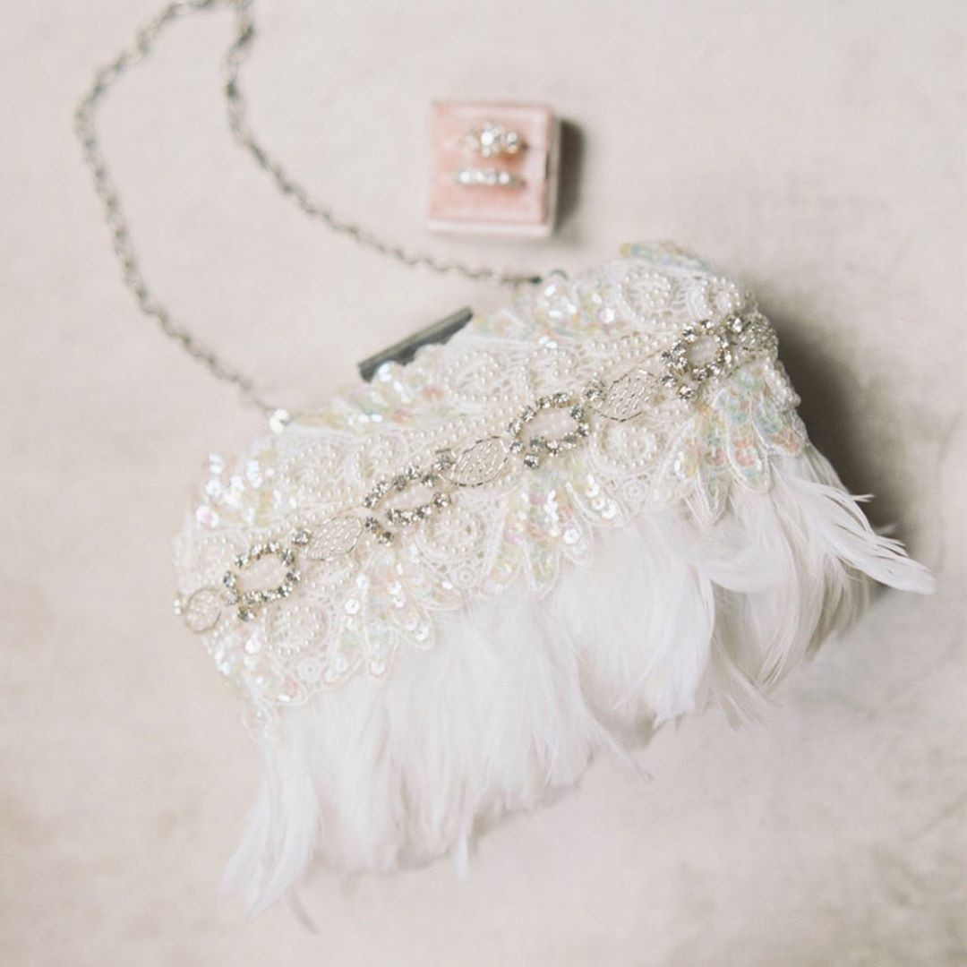 "Elegant is the name of this gorgeous brand new bridal clutch from our ""Che Bella"" collection. Beautiful ostrich feathers in ivory"